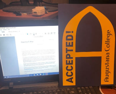 Gold 'A' with computer screen showing acceptance letter