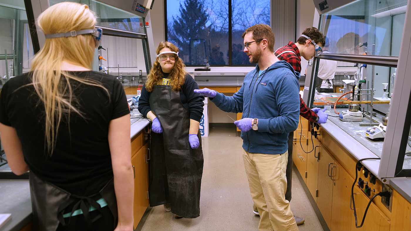 Domski and students in lab
