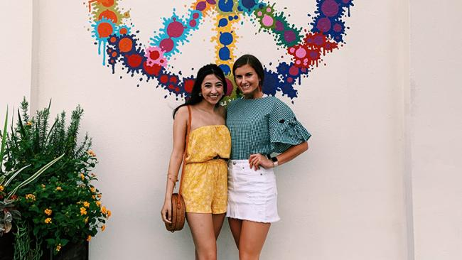 Brittany and Marisa in front of mural in Texas