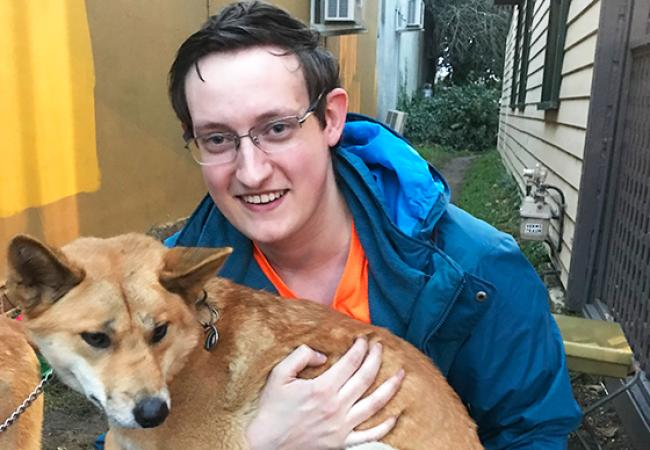 Ryan Johnson didn't spend all of his time with marine animals. Here he holds an Australian dingo.