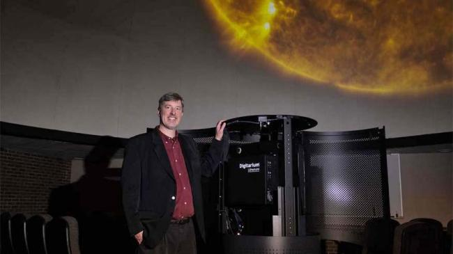 Dr. Lee Carkner, planetarium director and professor of physics