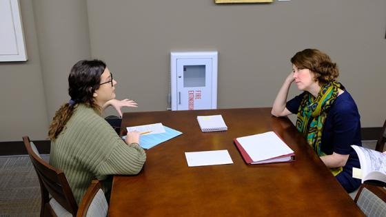 Student and professor talk admissions requirements