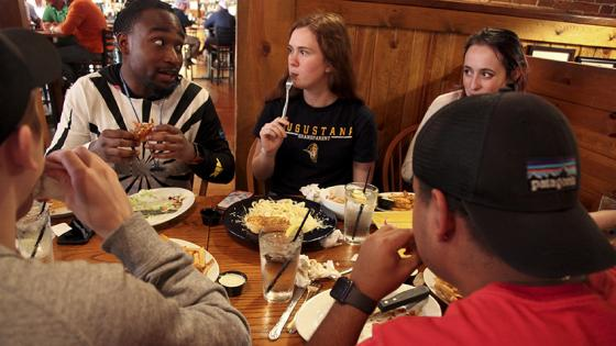 Students enjoy a meal off campus