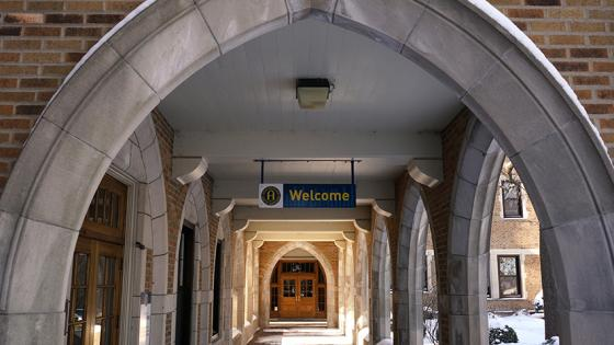 Welcome sign between arches