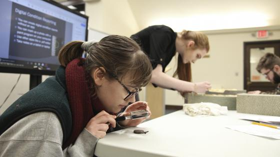 Students study artifacts during J-term course